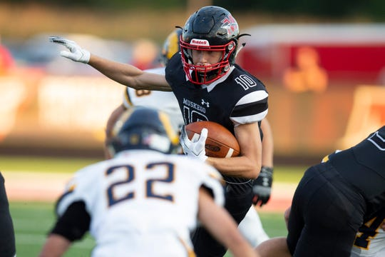 Muskego  running back Andrew Leair makes a move in the first quarter.