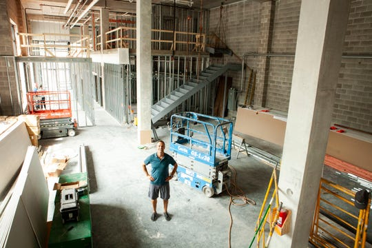 Pete Mueller stands inside the new gym space for his personal training company, Pete Mueller Group LLC, at 555 W. McKinley Ave. in the Deer District near Fiserv Forum.