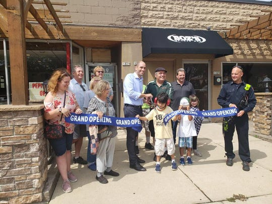 West Allis Mayor Dan Devine celebrates the grand opening of Pepi's Pizza in West Allis on Aug. 21.