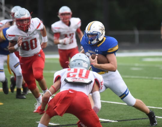 Mountain Home's Gage Hershberger carries against Highland during last week's scrimmage.