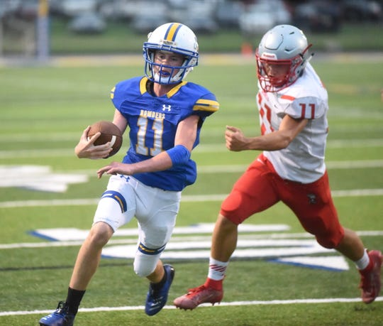 Mountain Home's Brody Patterson scores a touchdown in the Bombers' scrimmage against Highland on Thursday night.