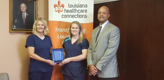 Dr. Marcus Wallace, MD, MBA, FACP, Senior Vice President of Medical Affairs for Louisiana Healthcare Connections, presented the OB/GYN Physician Summit Award to Dr. Dawn Pennebaker, MD, OB/GYN with The Woman's Clinic of Monroe, on Aug. 21, 2019. The award recognizing Pennebaker for achieving the highest quality scores in key quality measures related to women's health across the health plan's provider network. Accepting the award on Pennebaker's behalf were Caitlin Crow, LPN, and Tanya Rabb, LPN.