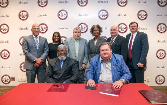 A Memorandum of Understanding to work together to improve the lives of senior citizens became official Wednesday, Aug. 21, 2019, between the University of Louisiana Monroe and Northeast Delta Human Services Authority. Signing the agreement were, seated, from left, Northeast Delta HSA Executive Director Dr. Monteic A. Sizer and Office of Sponsored Programs and Research Director Dr. John Sutherlin. Participating in the event were, standing, from left, Vice President of Academic Affairs Dr. Alberto Ruiz, HSA Wellness and Prevention Services Director Dr. Avius Carroll, HSA Board President Michael Shipp,  Director of the School of Behavioral and Social Sciences Dr. Pamela Higgins-Saulsberry, Endowed Professor of Gerontology in the School of Allied Health Dr. Burt Ashworth and Dean of the College of Business and Social Science Dr. Ron Berry.