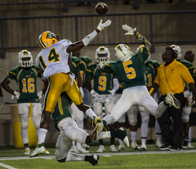 Carver's Ken'Damion Smith (5) breaks up a pass intended for Jeff Davis' Tavares Womack (14) at Cramton Bowl in Montgomery, Ala., on Thursday, Aug. 22, 2019. Carver defeated Jeff Davis 18-13.