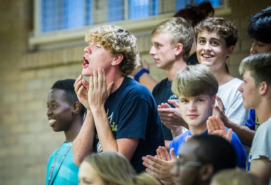 Burris fans cheer on their team during their game against Monroe Central at Ball Gym.