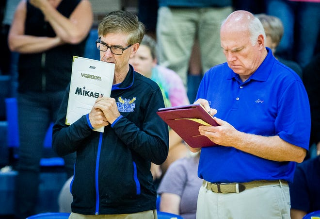 FILE -- Former Burris head coach Steve Shondell (left) chats with Jim Craig courtside during a game against Monroe Central at Burris High School. Craig was selected as the Owls' head coach on Friday, April 24.