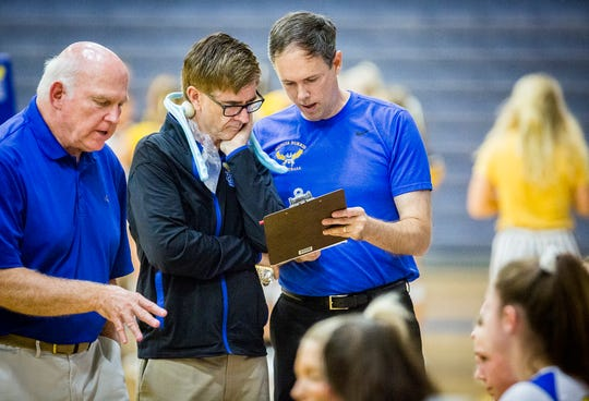 FILE -- Jim Craig (left), who was hired as Burris' head coach on April 24, 2020, leads a huddle during a match against Monroe Central at Burris High School Thursday, Aug. 22, 2019.