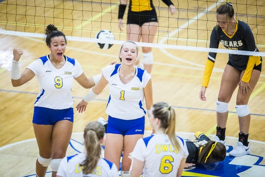 Burris celebrates a point against Monroe Central during their game at Burris High School Thursday evening.