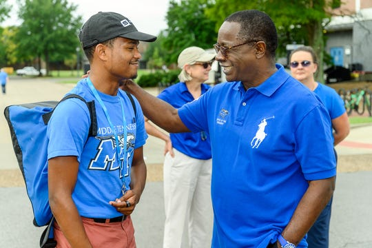 Killian Gunn, 18, an MTSU freshman from Knoxville, Tennessee, and MTSU President Sidney A. McPhee talk Friday during We Haul move-in day on campus. In the background are Debra Sells, vice president of Student Affairs and Enrollment Management, and Sarah Sudak, associate vice president, associate VPSA and dean of Student Life.