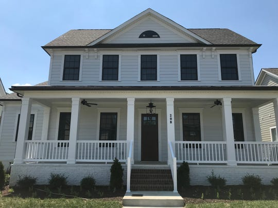 The modern farmhouse is the most requested home design in the country. Celebration Homes built this one in Durham Farms.