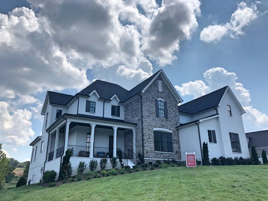 This home, built by Willow Branch Partners, is one of the first homes ready for purchase in Vineyard Valley. This 4-bedroom, 3.5-bath home has a three-car garage and backs up to green space. It is listed at $690,780.