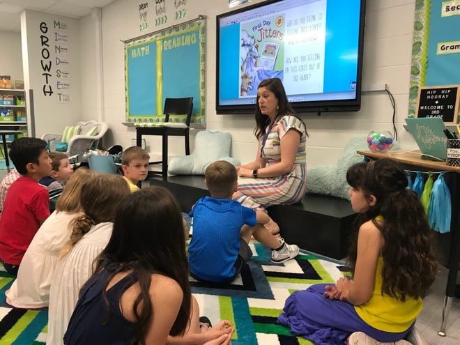 Franklin Special School District recently retained staffing firm StaffEZ, which will offer health insurance to substitute teachers as well as increase the district's pool of subs. (Pictured) Students get settled on the first day of school at Franklin Elementary School.