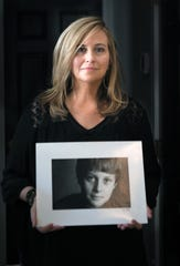 Former Mayor Megan Barry holds on her favorite childhood photograph of her son, Max, in her Nashville home on Thursday, August 22, 2019.  Max Barry died of a drug overdose at the age of 22.