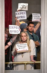 Protesters raise signs in the gallery asking for Rep. David Byrd to be expelled during a special session of  the legislature. The Waynesboro representative announced that he will not run for reelection after being dogged with allegations of sexual assault. Friday, Aug. 23, 2019, in Nashville, Tenn.