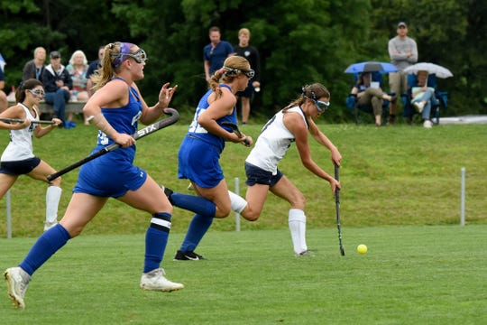 Olentangy defenders chase after Granville sophomore Mallory Lindsey during an Aug. 22 match at Granville Intermediate School. The Blue Aces lost 1-0.