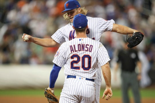 New York Mets starting pitcher Noah Syndergaard and first baseman Pete Alonso (20) celebrate after Cleveland Indians' Greg Allen grounded out to end the top of the sixth inning of a baseball game Thursday, Aug. 22, 2019, in New York. (AP Photo/Mary Altaffer)