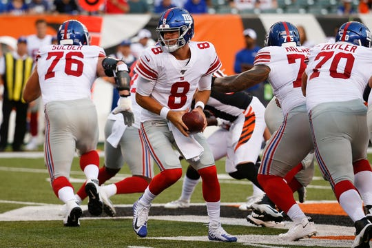 New York Giants quarterback Daniel Jones (8) looks to hand off the ball during the first half of an NFL preseason football game against the New York Giants, Thursday, Aug. 22, 2019, in Cincinnati.