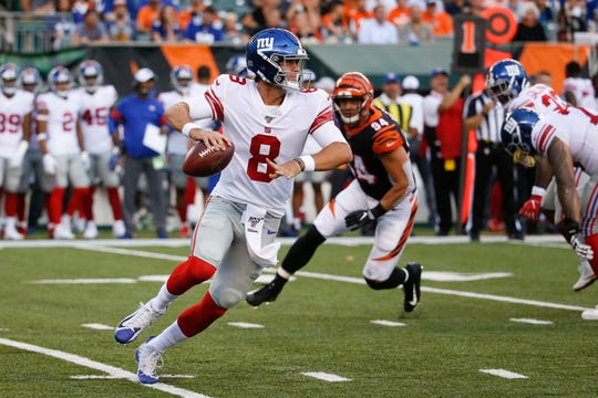 New York Giants quarterback Daniel Jones looks to pass on the run during the first half of the team's NFL preseason football game against the Cincinnati Bengals, Thursday, Aug. 22, 2019, in Cincinnati.