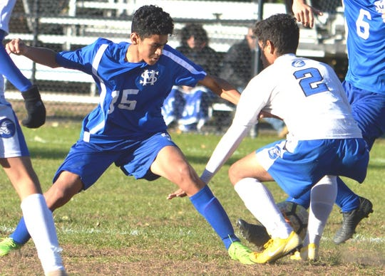 St. Mary sophomore Michael Hernandez (15) battling North Arlington sophomore Victor Batista in a game last season.