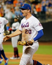 Aug 22, 2019; New York City, NY, USA; New York Mets first baseman Pete Alonso (20) reacts after making a diving stop on a ground ball for the third out against the Cleveland Indians during the sixth inning at Citi Field. Mandatory Credit: Andy Marlin-USA TODAY Sports