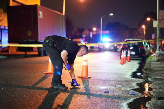 Police investigating at the scene of a shooting on Wall Street near Passaic Street in Passaic, NJ at about 2:30 a.m. on August 23, 2019.