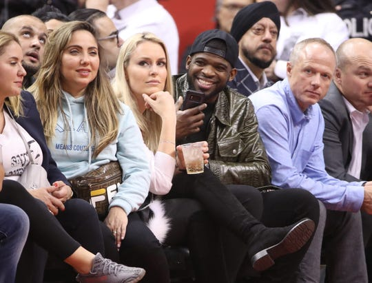 Apr 29, 2019; Toronto, Ontario, CAN; Skiier Lindsey Vonn and Nashville Predators defenseman P.K. Subban (center) look on from the sidelines during game two of the second round of the 2019 NBA Playoffs between the Toronto Raptors and the Philadelphia 76ers at Scotiabank Arena. Mandatory Credit: Tom Szczerbowski-USA TODAY Sports
