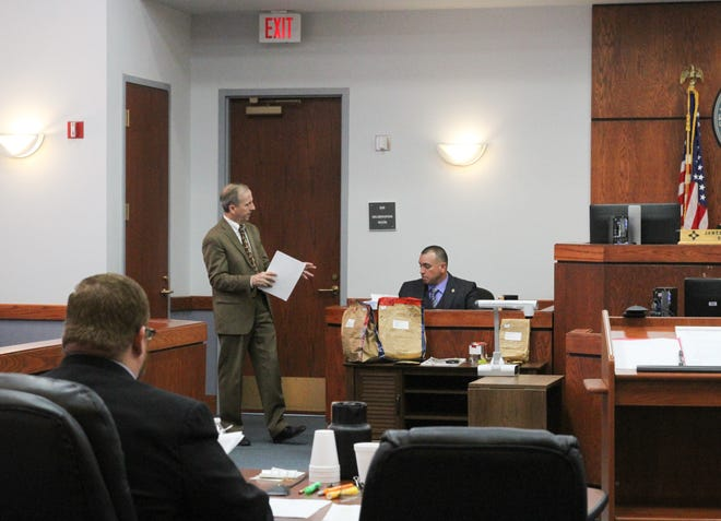 A lawyer with 12th Judicial District Attorney John P. Sugg's legal team questions Fabian Picazo, a detective involved with the AZ Boys case.