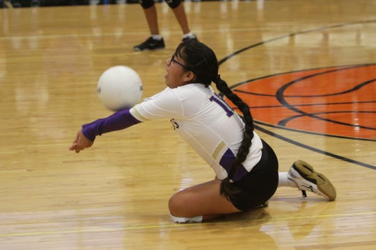 Kirtland Central's Kayleigh Cadman gets a dig against Navajo Prep during Thursday's volleyball match at the Eagles Nest in Farmington.