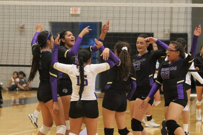 Kirtland Central celebrates winning a point against Navajo Prep during a volleyball match on Thursday, Aug. 22, 2019 at the Eagles Nest in Farmington.