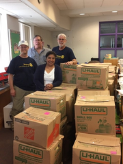 Steppingstone School staff members prepare to unload boxes following their move from Farmington Hills.