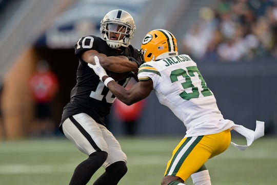 Raiders wide receiver Rico Gafford (10) rushes against Packers cornerback Josh Jackson (37) during the first half of an Aug. 22 preseason game in Winnipeg, Manitoba.