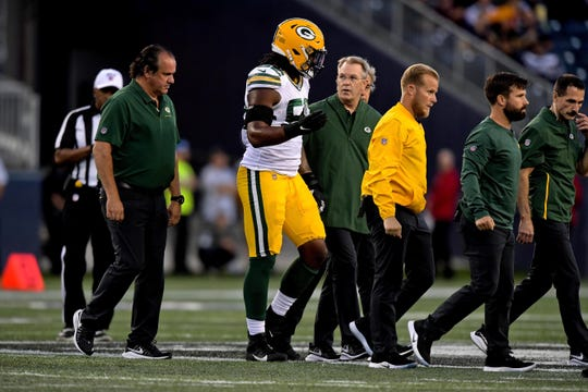 Aug 22, 2019; Winnipeg, Manitoba, CAN; Green Bay Packers linebacker Rashan Gary (52) leaves the field after suffering an apparent injury during the first half against the Oakland Raiders at Investors Group Field.