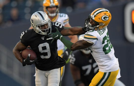 Raiders wide receiver De'Mornay Pierson-El (9) stiff-arms Packers cornerback Will Redmond (25) in the first half of an Aug. 22 preseason game in Winnipeg, Manitoba.