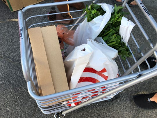 A community member's cart filled with produce from the event.