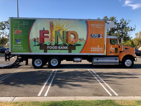 FIND Food Bank's truck at the James O. Jessie Desert Highland Unity Center. It brought 6,011 pounds of food to the distribution event.