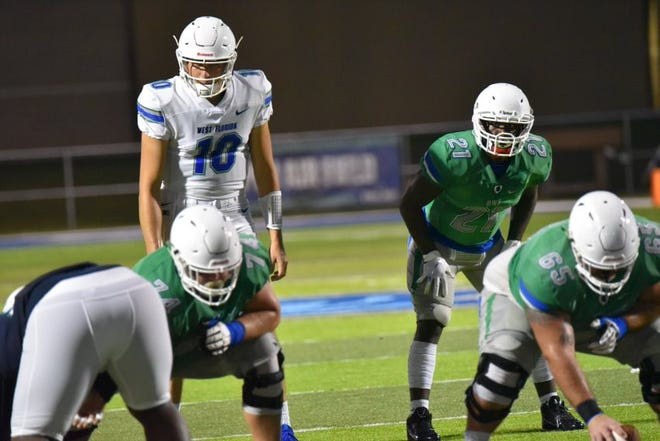 Colorado State transfer J.C. Robles (left) takes part in a scrimmage with UWF on Aug. 22, 2019.