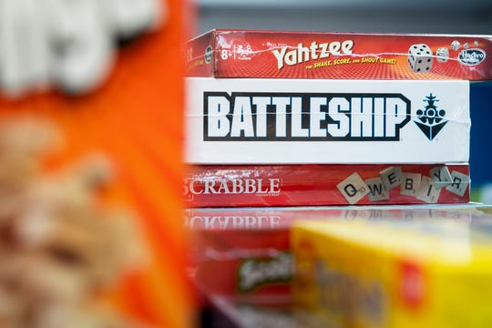 Board games including Yahtzee, Battleship and Scrabble are displayed inside Let's Play: Games and Hobbies in Hanover.