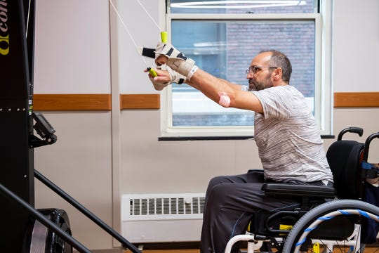 Dave Meixner works on a pulley machine, called a skier, during a therapy session at Magee Rehabilitation Hospital in Philadelphia on Monday, August 19, 2019. He can use his arms, but he has lost feeling in parts of both hands and arms.