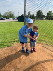 Jacob, left, poses with his brother Joshua at Jacob's T-ball game at Pleasant Hill Fire Department Field in March 2019.