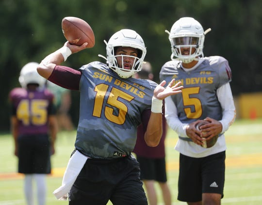 ASU quarterback Dillon Sterling-Cole (15) throws as quarterback Jayden Daniels (5) watches during practice at Camp Tontozona August 7, 2019.