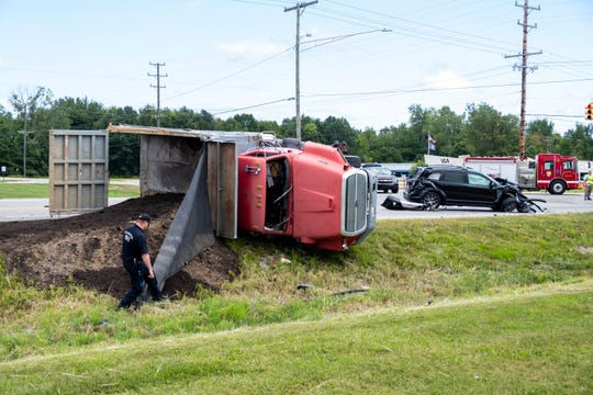 A two vehicle crash left a dump truck on its side and an SUV damaged near the intersection of Dove and Michigan roads in Port Huron Township.