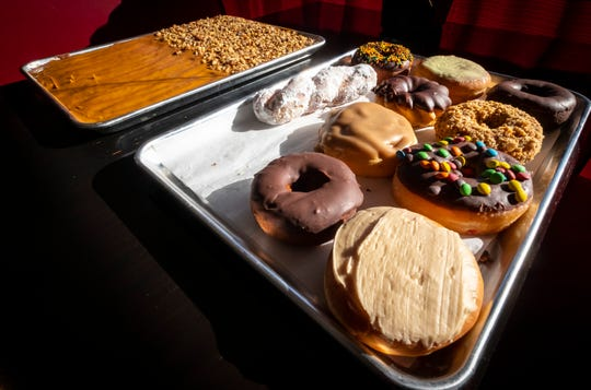 An assortment of donuts are arranged on a tray at New Haven Sweet Shoppe and Bakery in Port Huron.