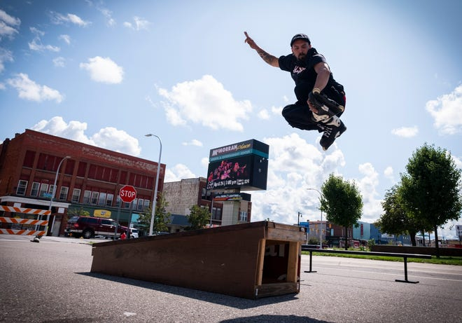 Adam Keller jumps off a grind box on his inline skates Friday, Aug. 23, 2019, at a fundraiser for a new skatepark. The local skating community is trying to raise money for a $250,000 matching grant through the Tony Hawk and Ralph C. Wilson Jr. foundations.