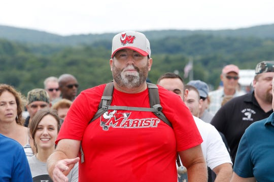 Tommy Zurhellen leading a group of supporters across the Walkway Over The Hudson on August 23, 2019. Tommy Zurhellen returned home to Poughkeepsie today after walking across the country to raise awareness of veterans issues.