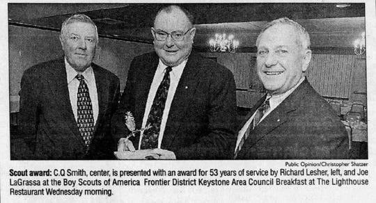 "Charles Quinton ""C.Q."" Smith, center, is shown in a photo that ran in the Chambersburg Public Opinion in 2002. The Boy Scouts of America honored him for 53 years of service. He served as scoutmaster of Boy Scout Troop 127 from 1966 to 1991."