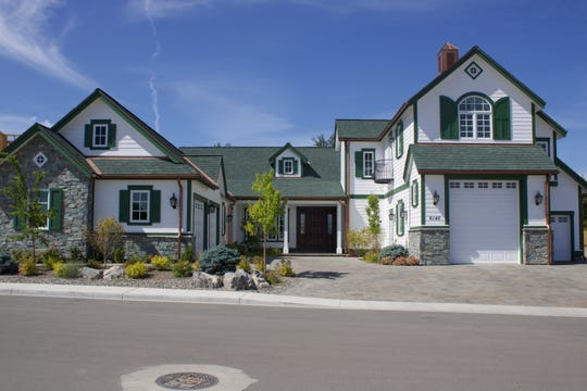 The first custom home recently completed at Rancharrah pays homage to the white and green color scheme of the original Rancharrah Mansion, soon to be the community's clubhouse.