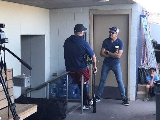 Eric Byrnes chats with Aces slugger Kevin Cron at Greater Nevada Field on Thursday.
