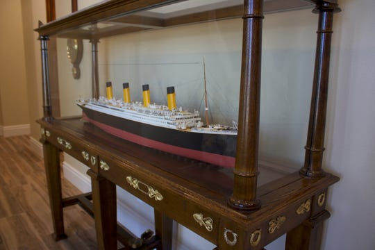 A replica of the Titanic docks in a hallway of the first custom home recently completed at Rancharrah.