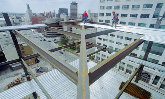 1994: Donald Fisher, left and Jim Welker work on the decking of the Bausch & Lomb downtown office tower that was announced in August 1992.