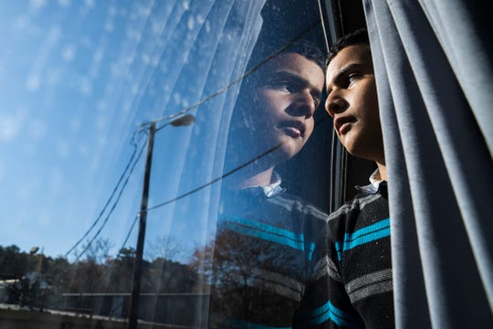Looking out a bus window.  One of the Central American refugees.